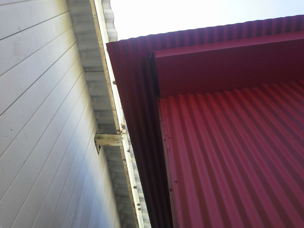 Painted Corrugated with Boxed Rafters